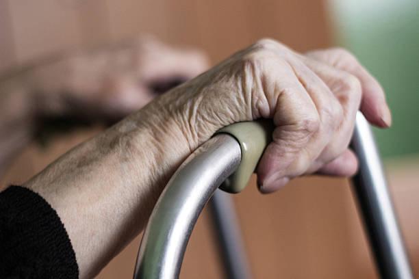 Grandmother hands using a walker as support
